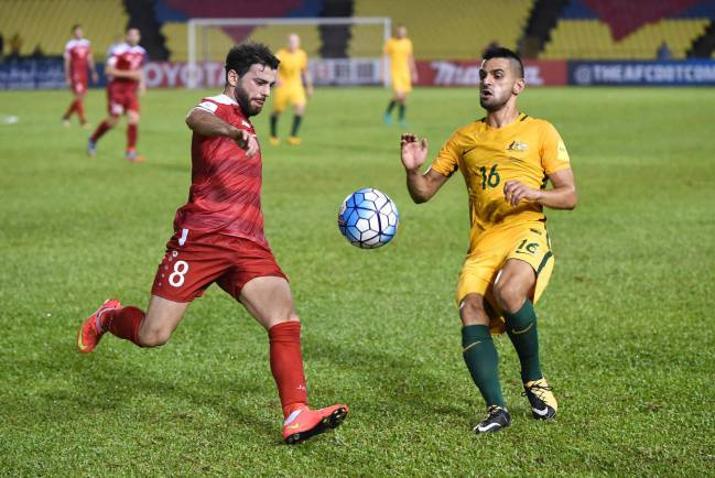 A late penalty from Omar Al-Somah secured a draw for Syria in the first leg of their World Cup qualifier play-off against the Socceroos, for whom Kruse had scored.