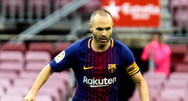 Iniesta signs lifelong deal at Barcelona