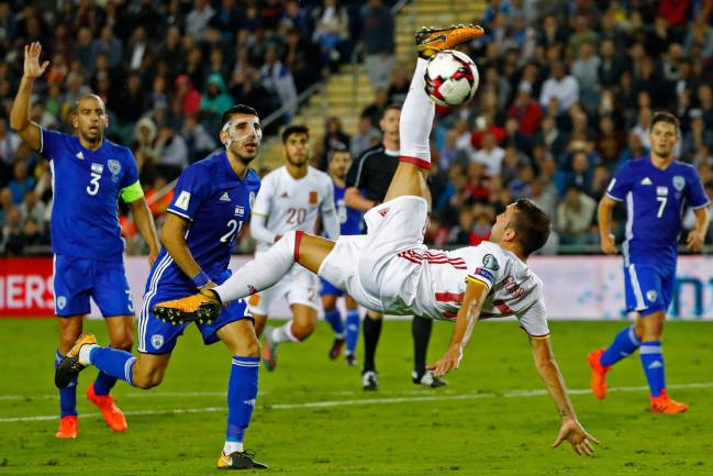 Spain's forward Iago Aspas goes airborne in his efforts for his country.