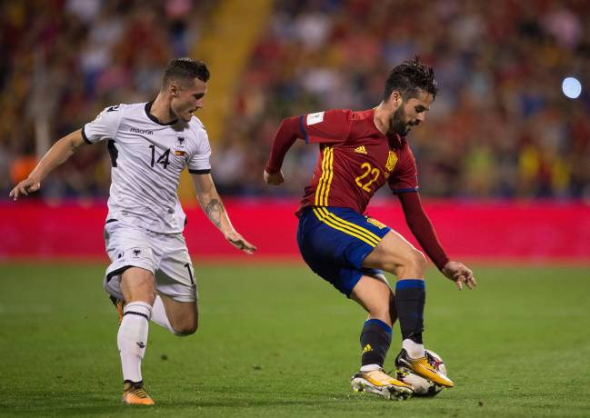 Isco with a typical turn away from Albania's Taulant Xhaka as Spain control the FIFA 2018 World Cup Qualifier.