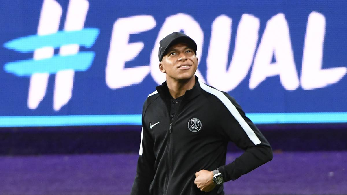 Paris Saint-Germain (PSG) player Kylian Mbappe walks on the pitch, at the Constant Vanden Stock Stadium in Brussels
