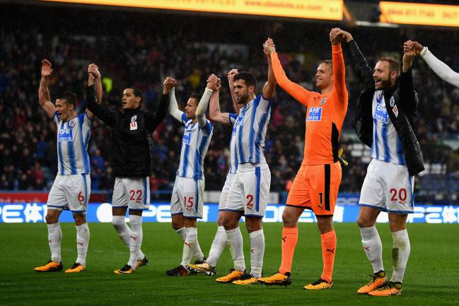 Huddersfield Town players celebrate after beating Manchester United.
