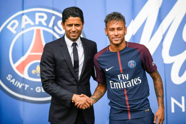 Brazilian superstar Neymar shaking hands with Paris Saint Germain's Qatari president Nasser Al-Khelaifi after agreeing a five-year contract following his world record 222 million euro ($260 million) transfer from Barcelona to PSG.