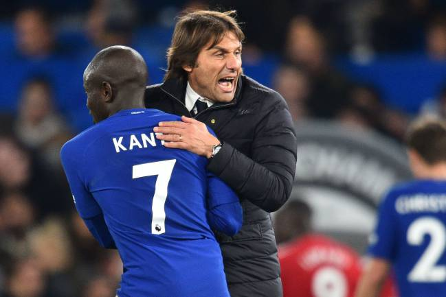 Chelsea's Italian head coach Antonio Conte celebrates on the pitch with N'Golo Kante in the win over Manchester United.