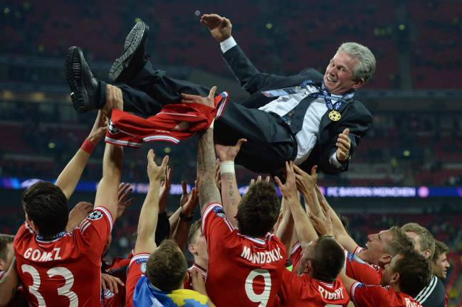 Current Bayern Munich head coach Jupp Heynckes being thrown in the air by the players after their victory in the UEFA Champions League final in his previous stint.