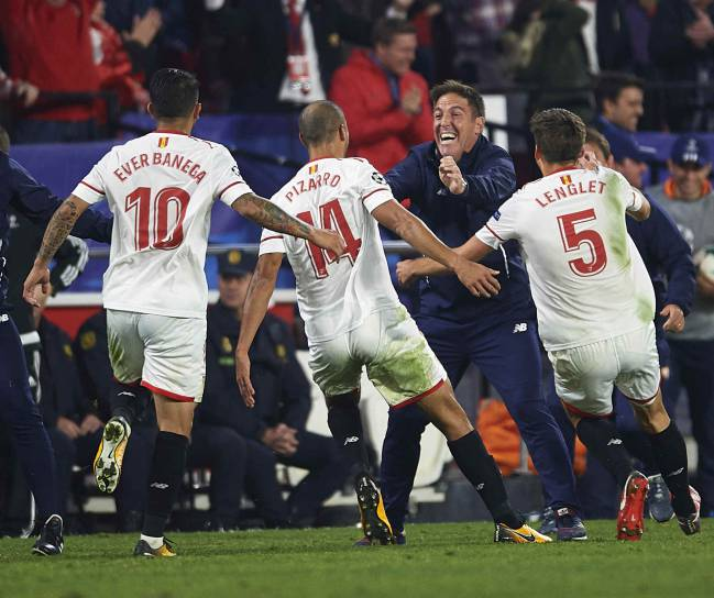 Guido Pizarro of Sevilla FC celebrates his last gasp equaliser with Head Coach Eduardo Berizzo during the UEFA Champions League group E match against Liverpool.