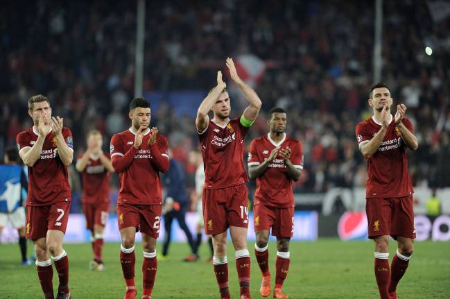 Liverpool's players applaud their fans at the Ramon Sanchez Pizjuan stadium in Sevilla after a bitter second half showing.