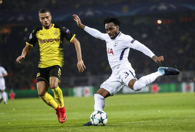 Dortmund's Jeremy Toljan challenges Danny Rose during the Group H clash of the Champions League in Germany.