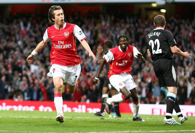 Arsenal's Czech midfielder Tomas Rosicky celebrates scoring his side's opening goal against Man City in 2007, with team mate Emmanuel Adebayor chasing behind.
