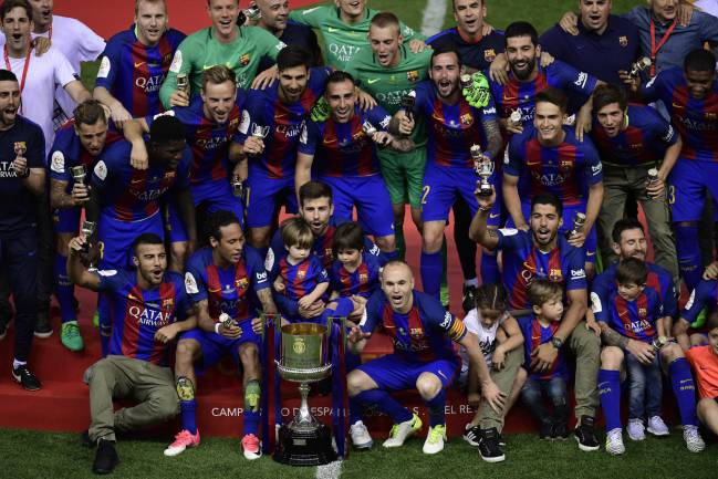 Aim to retain | Barcelona players and staff pose with the Copa del Rey trophy at the Vicente Calderon stadium in Madrid on May 27, 2017.