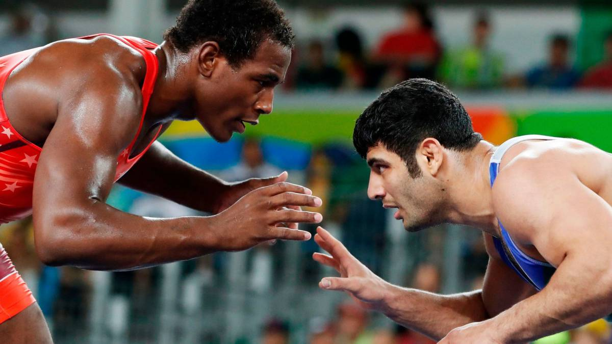 At the Olympics in Rio de Janeiro in 2016, the Iranian wrestler Alireza Karimi-Machiani, right, lost to the American J'Den Cox.