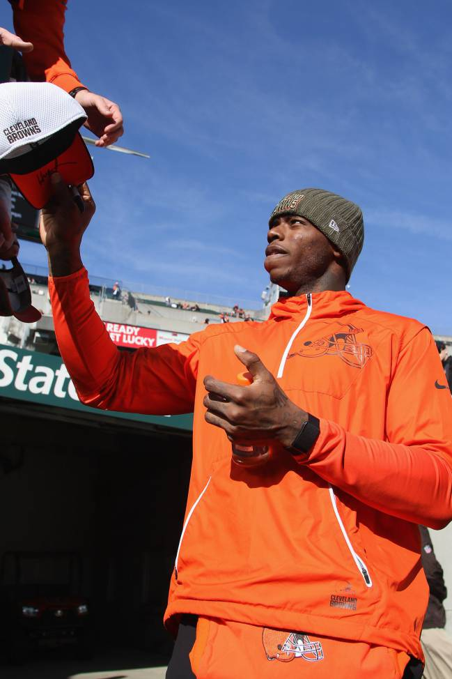 osh Gordon of the Cleveland Browns signs autographs for the fans