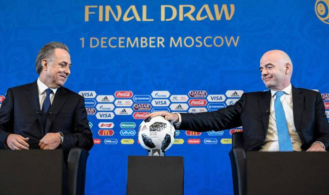 FIFA president Gianni Infantino (R) and Russian deputy prime minister Vitaly Mutko give a press conference prior to the Final Draw for the 2018 FIFA World Cup.