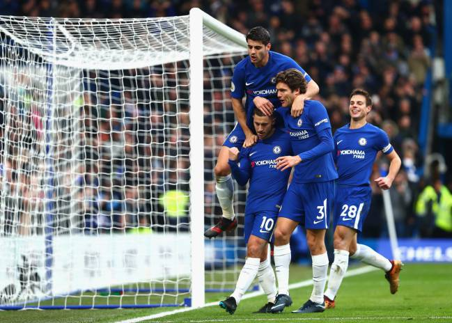 Eden Hazard celebrates after scoring his side's third goal with Alvaro Morata and Marcos Alonso during the Premier League match between Chelsea and Newcastle United at Stamford Bridge.