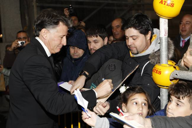 Sebastian Coe signs autographs for waiting fans before the event.