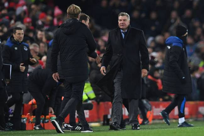 Who's the happier? Liverpool's Jurgen Klopp and Everton's Sam Allardyce shake hands at the end of the derby.