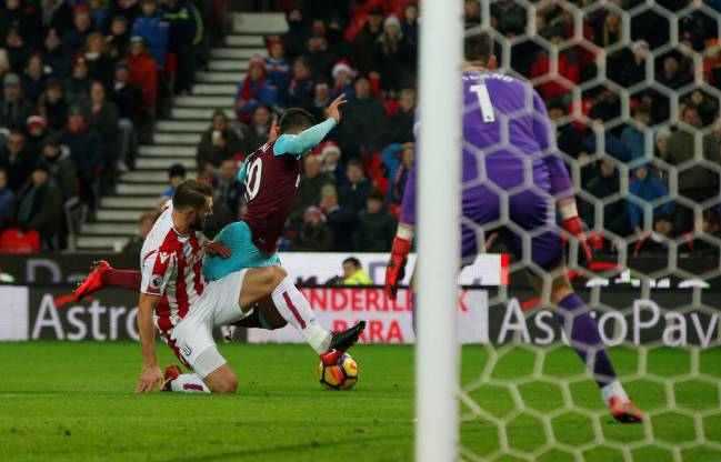 Stoke City's Erik Pieters fouls West Ham United's Manuel Lanzini and referee Graham Scott consequently awards a penalty.