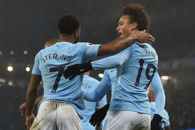 Manchester City's English midfielder Raheem Sterling joins in the celebrations during their Spurs mauling.