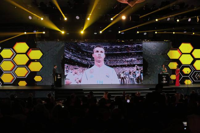 "Cristiano Ronaldo is seen on a screen after the announcement of his reception of the ""Best player"" award during the Globe Soccer Awards Ceremony"