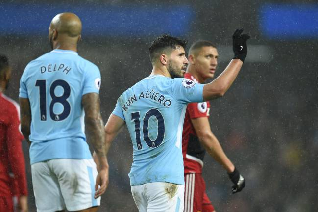 Manchester City's Argentinian striker Sergio Aguero celebrates after scoring their third goal during the English Premier League football match against Watford.