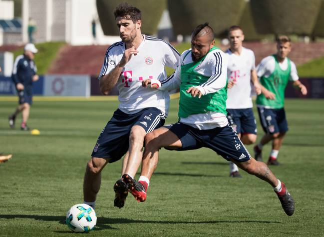 Javi Martinez is challenged by Arturo Vidal during a training session on day 2 of the FC Bayern Muenchen training camp at ASPIRE Academy for Sports Excellence on January 3, 2018 in Doha, Qatar.