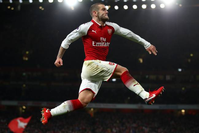 Jack Wilshere of Arsenal celebrates after scoring his sides first goal during the Premier League match against Chelsea.