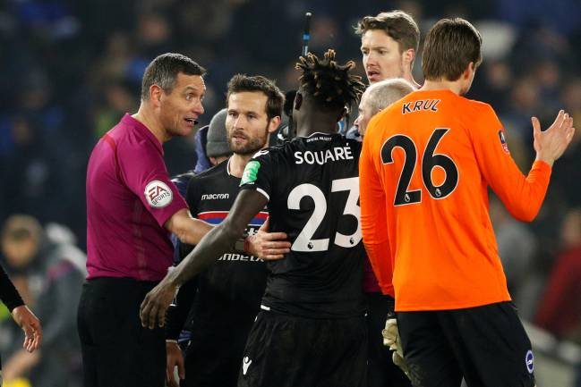 Referee Andre Marriner talks to Crystal Palace's Pape Souare and Yohan Cabaye at the end of the match.
