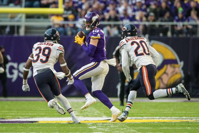 Minnesota Vikings wide receiver Adam Thielen (19) makes a catch during the third quarter against the Chicago Bears at U.S. Bank Stadium.