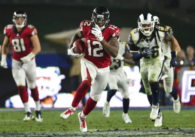 Atlanta Falcons wide receiver Mohamed Sanu (12) runs the ball after making a reception against the Los Angeles Rams during the second half in the NFC Wild Card playoff football game at the Los Angeles Memorial Coliseum.