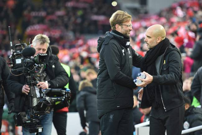 Manchester City's Pep Guardiola shakes hands with Liverpool's Jürgen Klopp after their teams' thrilling 4-3 game.