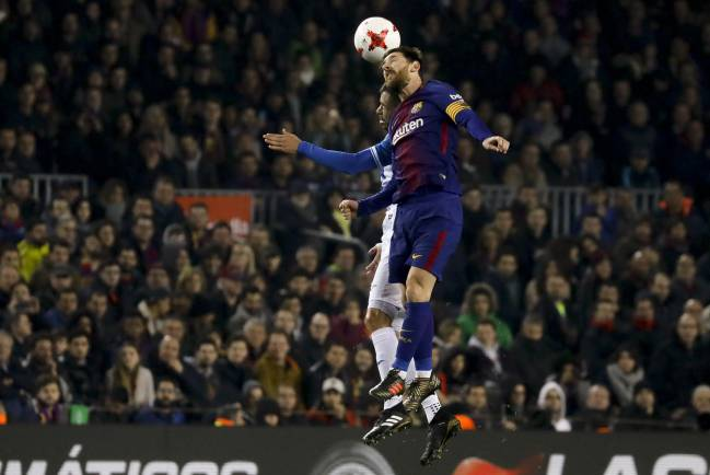 Lionel Messi headers the ball against Espanyol on Thursday night.