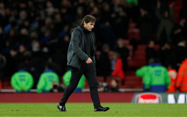 Chelsea manager Antonio Conte looks dejected after the defeat to Arsenal.