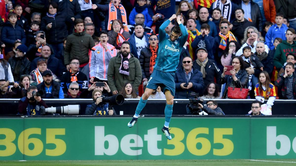 Cristiano Ronaldo of Real Madrid celebrates scoring his side's first goal  during the La Liga match between Valencia and Real Madrid at Estadio Mestalla