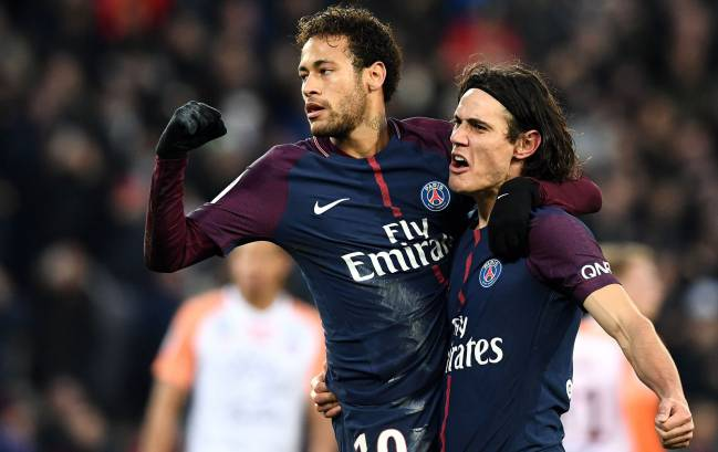 PSG's Brazilian forward Neymar is congratuled by Edinson Cavani after scoring a penalty against Montpellier.