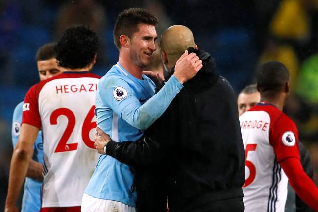 New boy | Manchester City manager Pep Guardiola celebrates with Aymeric Laporte after defender's debut against West Brom.
