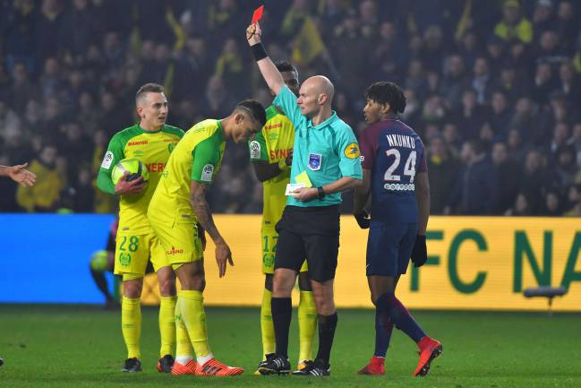 January 14, 2018 | French referee Tony Chapron shows red card to Nantes' Brazilian defender Diego Carlos.