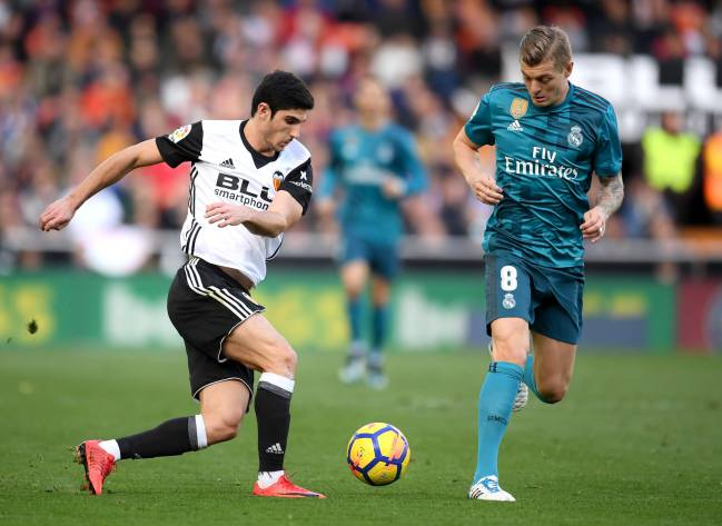 Goncalo Guedes of Valencia and Toni Kroos of Real Madrid battle for the ball during the La Liga match.