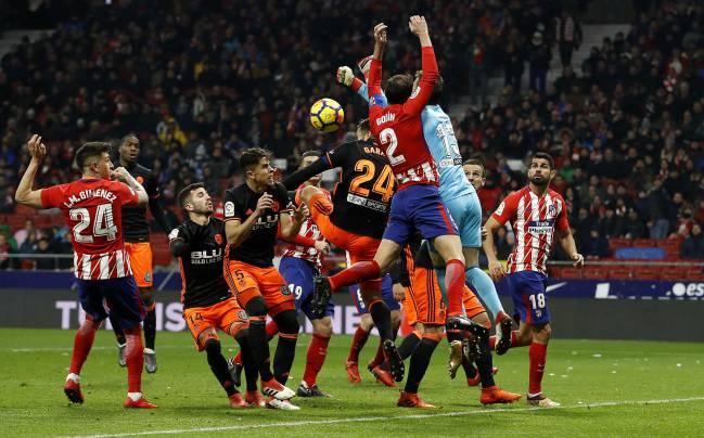 Godín lost several teeth in the collision with Valencia keeper Neto