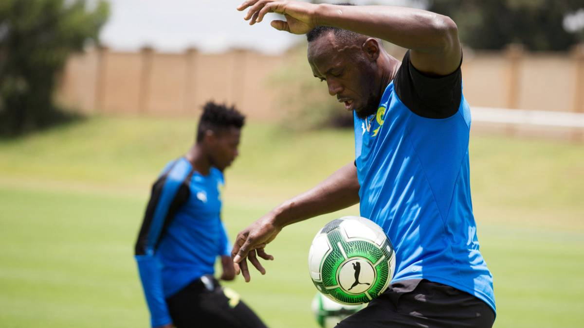 "Usain Bolt has ""a bit of work to do"" to make it as footballer"