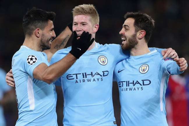 Sergio Aguero celebrates his team's third goal with team mates Kevin de Bruyne and Bernardo Silva.
