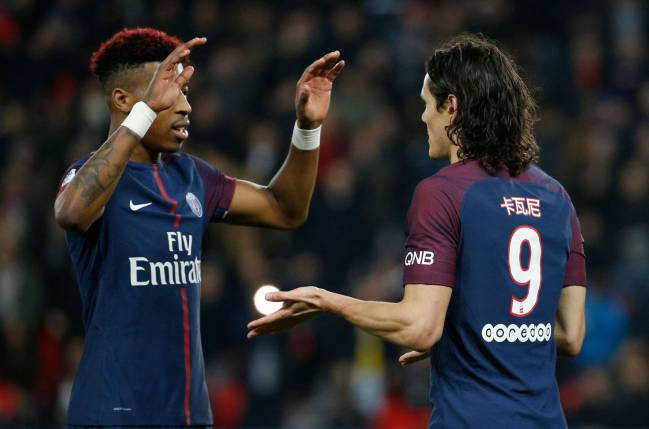 PSG's Edinson Cavani celebrates with defender Presnel Kimpembe.