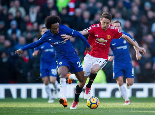 Manchester United's Nemanja Matic and Chelsea's Willian battling at Old Trafford.
