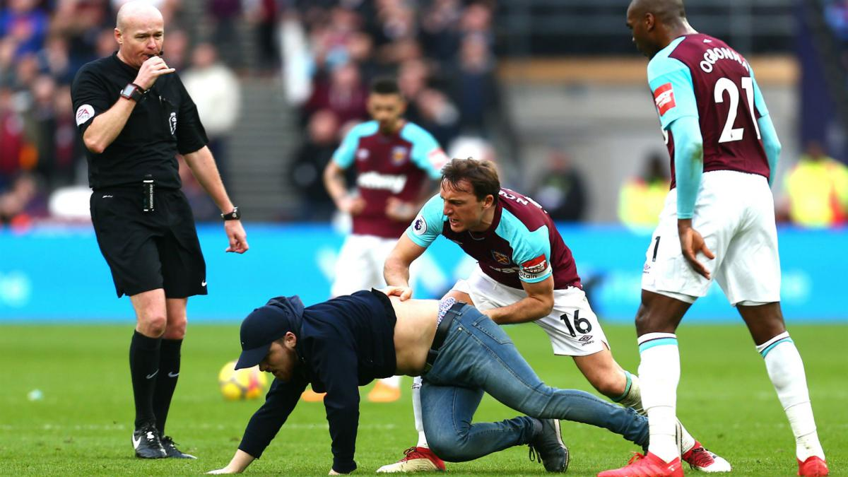Ugly scenes as West Ham fans interrupt Premier League game and scuffle in stands