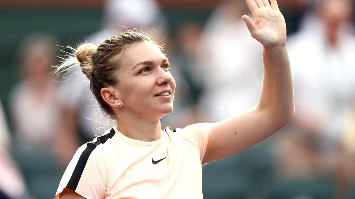 Halep overcomes stuttering start to progress at Indian Wells