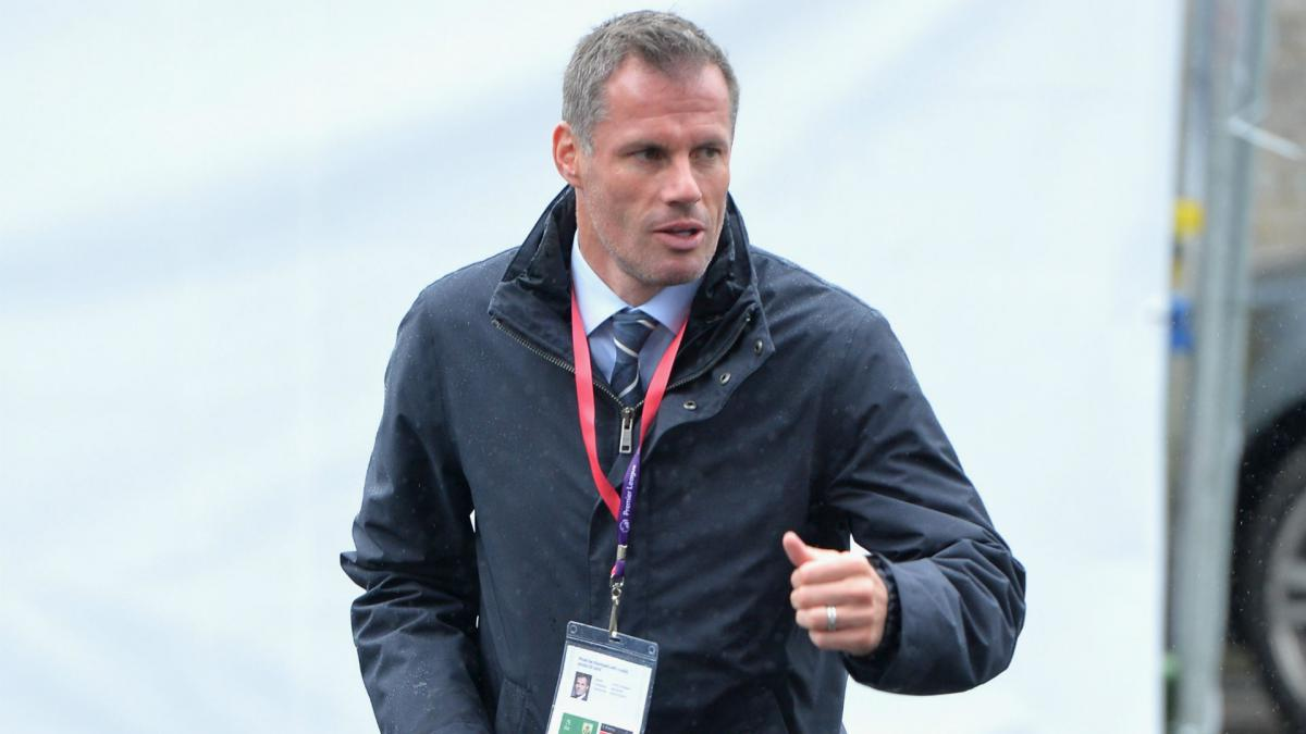 Liverpool great Carragher apologises for spitting at Man United fan