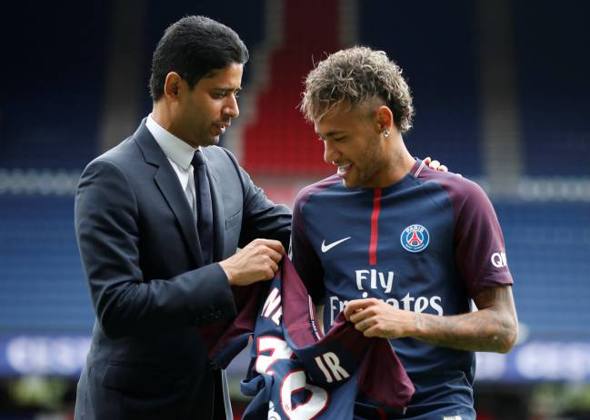 Happy days | New Paris Saint-Germain signing Neymar Jr and club president Nasser Al-Khelaifi pose with the club shirt.