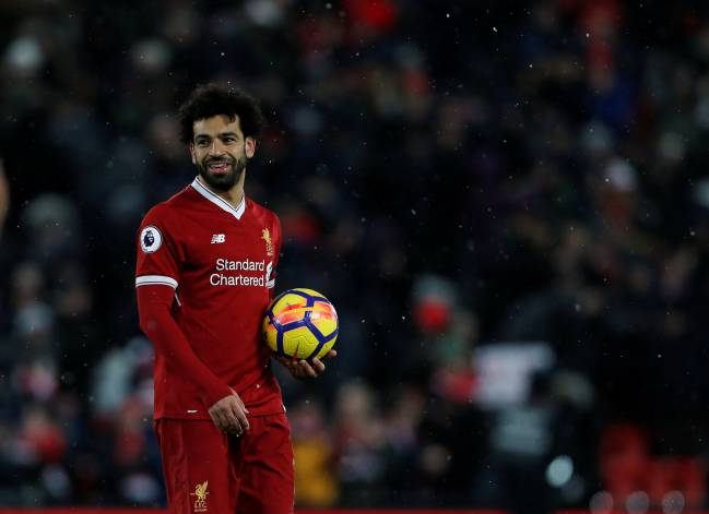 Hats off | Liverpool's Mohamed Salah celebrates with the match ball.