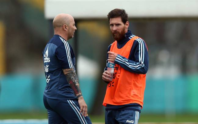 Argentina's head coach Jorge Sampaoli talks to Lionel Messi during a training session ahead of international friendly.