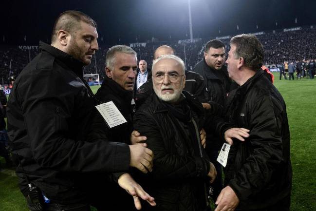 Ivan Savvidis, owner of Greek club PAOK, has been banned for three years after storming on to the pitch with a holstered gun on his belt.