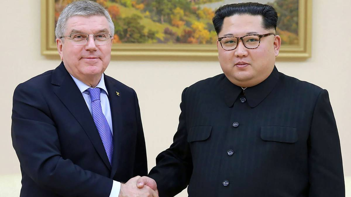 North Korean leader Kim Jong-Un (R) shaking hands with President of the International Olympic Committee Thomas Bach